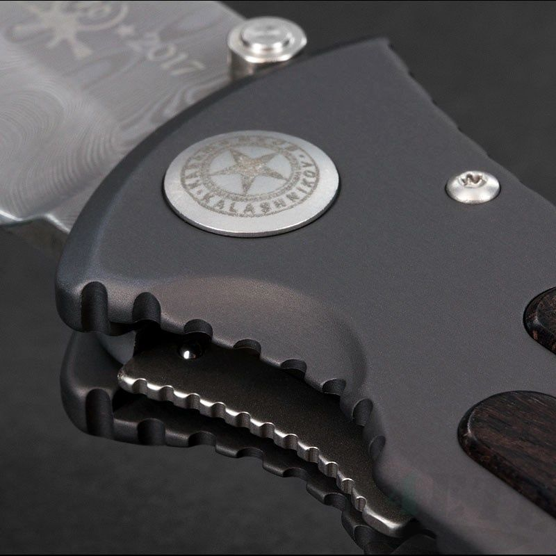 картинка Складной нож Boker Kalashnikov 70th Damascus Grenadill Wood (Юбилейный) 11KAL70DAM от магазина ma4ete